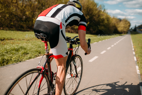 Cyclist in helmet and sportswear rides on bicycle - Stock Photo - Images