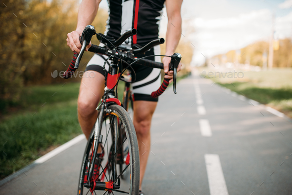 Cyclist in helmet and sportswear, bicycle training - Stock Photo - Images