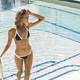 Beautiful woman in a bikini in a swimming pool. - PhotoDune Item for Sale