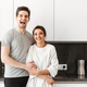 Portrait of a cheerful young couple hugging - PhotoDune Item for Sale