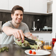 Portrait of a happy young man having healthy breakfast - PhotoDune Item for Sale