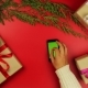 Top View Christmas Hands Using Touchscreen Smartphone Tablet Christmas Presents Shopping List - VideoHive Item for Sale