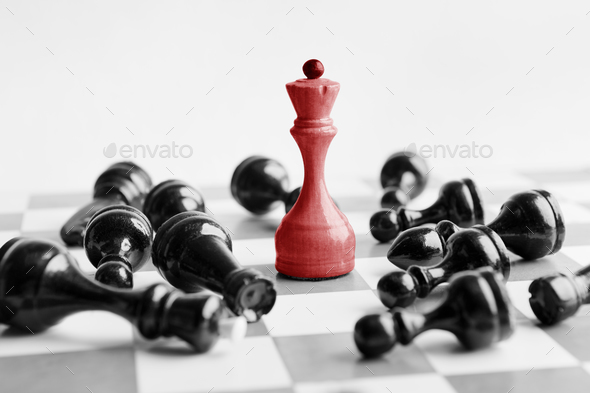 White chess queen beats blacks on chessboard - Stock Photo - Images
