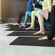 Young women and men in yoga class, relax meditation pose - PhotoDune Item for Sale