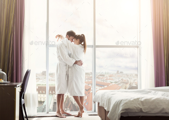 Young couple in love in hotel room in the morning - Stock Photo - Images