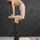 Young couple practicing acroyoga on mat together - PhotoDune Item for Sale