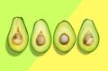 Green avocado cut in halves,flat lay