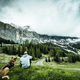 Man with dog on road trip at Gardena pass in Italy - PhotoDune Item for Sale