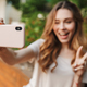 Smiling young girl in casual clothes taking selfie - PhotoDune Item for Sale