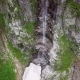 Aerial View of the Waterfall Highly in the Alpine Mountains - VideoHive Item for Sale
