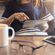 Young woman using smart phone in coffee shop drinking coffee - PhotoDune Item for Sale