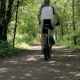 The Athlete Man Drives Through the Forest on a Bicycle. Healthy Lifestyle. - VideoHive Item for Sale