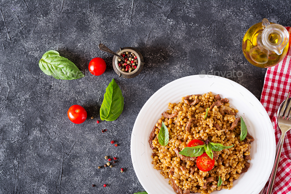 Israeli couscous with beef. Tasty food. Asian meal. Top view. Flat lay. - Stock Photo - Images