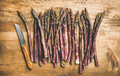 Fresh purple asparagus over wooden background - PhotoDune Item for Sale