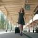 Young Slender Woman Is Travelling and Walking on Train Station with Suitcase - VideoHive Item for Sale