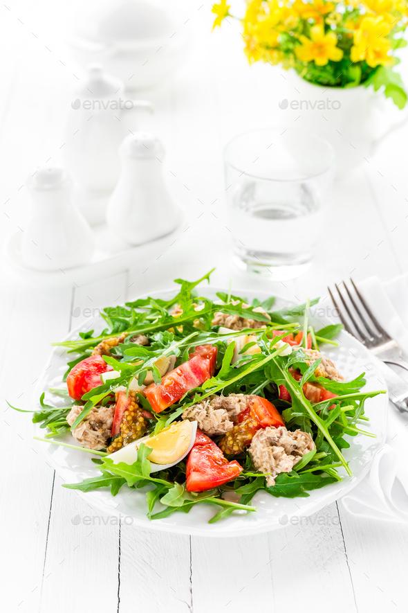 Salad with tuna. Vegetable salad with boiled egg, tuna and arugula. Fish salad - Stock Photo - Images