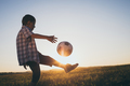 Young little boy playing in the field  with soccer ball. - PhotoDune Item for Sale