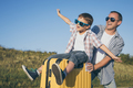 Father and son standing in the park at the day time. - PhotoDune Item for Sale