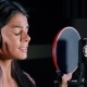 Young Beautiful Brunette Woman Recording Voice, Song or Album in Professional Studio. Girl Sings - VideoHive Item for Sale