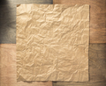 wrinkled paper at wooden background - PhotoDune Item for Sale