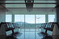 Modern airport departure lounge with plane taking off - PhotoDune Item for Sale