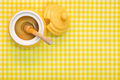 Honey pot and dipper on yellow background with copy space. - PhotoDune Item for Sale