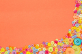 Colourful buttons on an orange background with copy space. - PhotoDune Item for Sale
