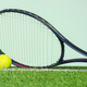 Tennis racket and ball on grass - PhotoDune Item for Sale