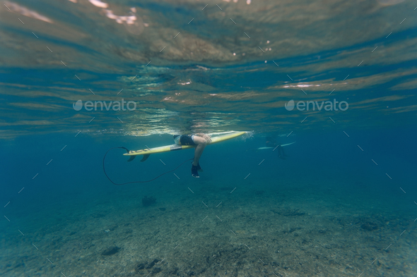 Surfer underwater view - Stock Photo - Images