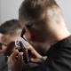 Tattoed Barber Makes Haircut for Customer at the Barber Shop By Using Hairclipper - VideoHive Item for Sale