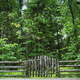 Log fence with sign near forest - PhotoDune Item for Sale