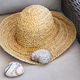 Straw hat with heart shaped rocks on chair - PhotoDune Item for Sale