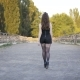 Young Woman Is Walking Along Large Road in Sunny Weather - VideoHive Item for Sale