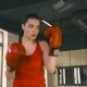 Young Woman Hitting a Boxing Bag - VideoHive Item for Sale