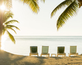 Sunset Over Tropical Beach Deckchairs - PhotoDune Item for Sale