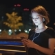 Portrait of Happy Young Woman Listening To Music on Smartphone in City at Night - VideoHive Item for Sale
