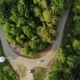 Aerial View of White Car Driving on Country Road in Forest - VideoHive Item for Sale