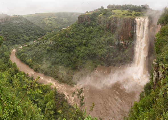 Flooded Umgeni River plunges 95 m down the Howick Falls - Stock Photo - Images