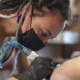 Tattoo Master Girl Stuffing a Tattoo on Her Arm - VideoHive Item for Sale