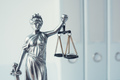 Lady Justice statue in law firm office - PhotoDune Item for Sale