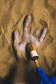 Forensic expert discovering dead body buried in desert sand - PhotoDune Item for Sale