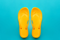 Yellow flip flops on blue background - PhotoDune Item for Sale