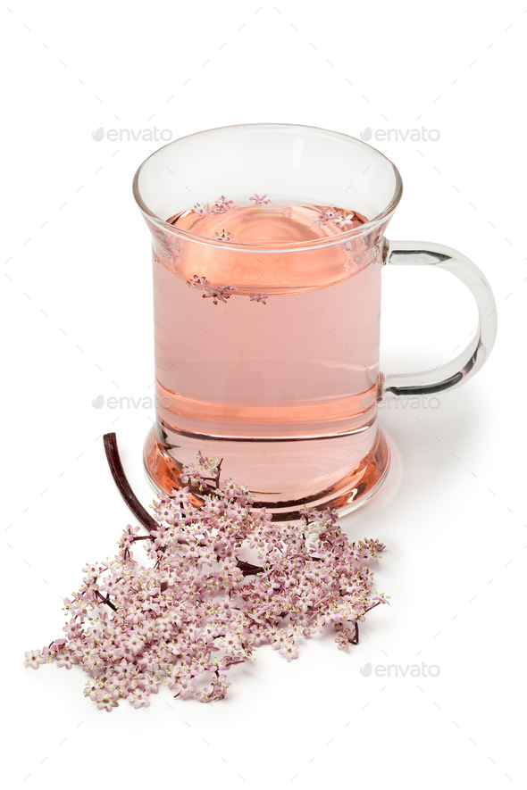 Glass with pink elderberry blossom tea - Stock Photo - Images