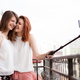 Happy and positive female friends taking a selfie - PhotoDune Item for Sale