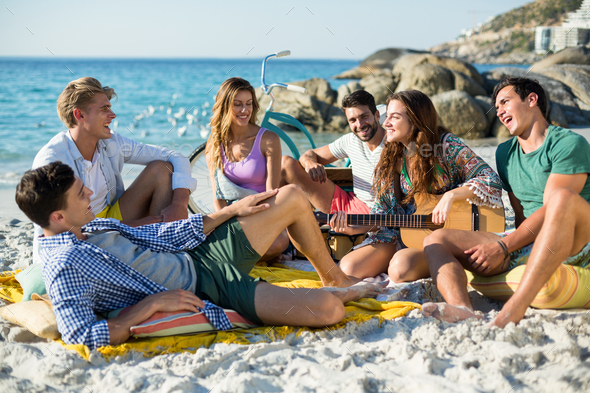 Friends having fun on shore - Stock Photo - Images
