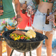 Friends having drinks by barbecue on shore - PhotoDune Item for Sale