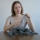 Woman Making a Ball From Grey Yarn - VideoHive Item for Sale