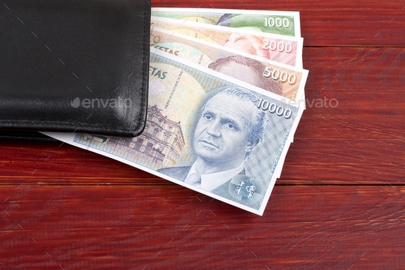 Money from Spain in the black wallet  - Stock Photo - Images