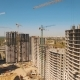 Construction of Houses. Fly Over Construction Site with Tower Cranes - VideoHive Item for Sale
