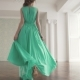 Fashionable Girl in a Fluttering Dress Go Away From the Camera and Looks Around - VideoHive Item for Sale